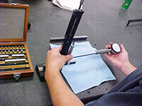 Calibrating a bore gage prior to inspecting a housing